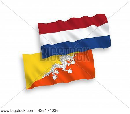 National Fabric Wave Flags Of Kingdom Of Bhutan And Netherlands Isolated On White Background. 1 To 2