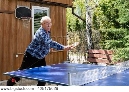 Senior Mature Grey Caucasian Old Male Person Making Strong Ball Shot Playing Ping Pong Table Tennis