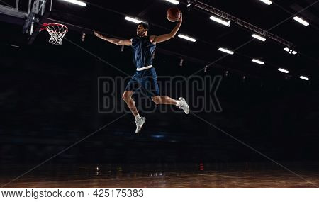 Young African Sportsman, Basketball Player Training In Gym, Idoors Isolated On Dark Background. Conc