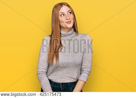 Young irish woman wearing casual clothes smiling looking to the side and staring away thinking.