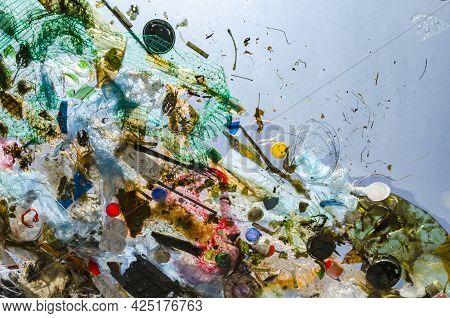 Pollution Of Ocean, Water. Plastic And Debris Float In Water.