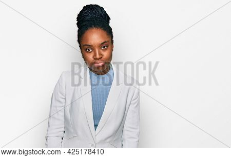 Young african american woman wearing business clothes depressed and worry for distress, crying angry and afraid. sad expression.