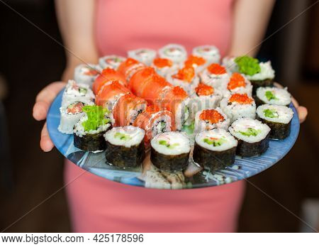 Making Sushi And Rolls At Home. Sushi With Seafood, Salad And White Rice. Food For Family And Friend
