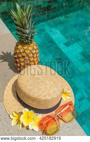 Hat, Glasses, Pineapple, Flowers By The Water. Summer Concept. Flatley By The Pool