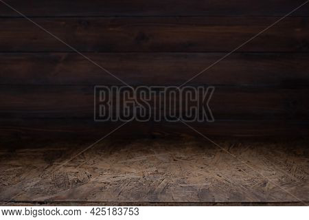 Wooden osb table top background texture.  Wood tabletop front view with copy space. Plank board surface