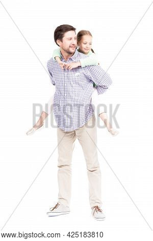 Vertical Full Length Isolated Shot Of Modern Caucasian Father Wearing Casual Clothes Carrying His Lo