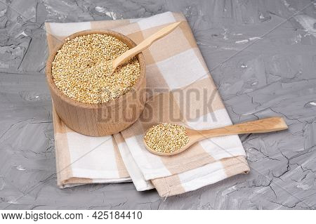 Dry Quinoa Cereal Bowls On Grey Concrete Background Table. Gluten Free Cereals