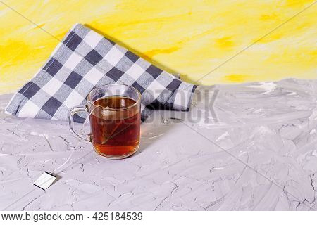 Cup Of Tea With Tea Bag And Copy Space. Hot Drink, Herb Tea. On A Yellow Gray Background