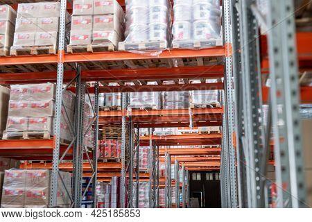 Racks with packed goods in warehouse of modern hypermarket