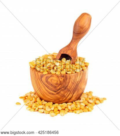 Dry Yellow Split Peas In Olive Bowl And Scoop, Isolated On White Background. Halves Of Yellow Legume
