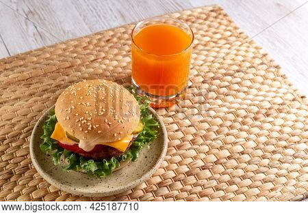 Delicious And Healthy Burger And Fruit Juice For Breakfast And Lunch. Homemade Recipe. Fast Food. Co
