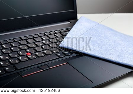 Laptop Keyboard And Cloth For Cleaning Surfaces. Disinfection New Normal For Cleaning Workplace Surf