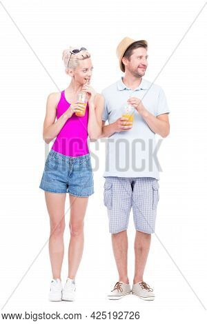 Vertical Full Length Studio Portrait Of Romantic Young Man And Woman Wearing Summer Outfits Standing