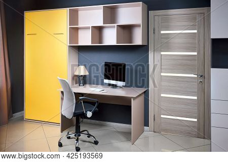 Bedroom Interior Flat With Yellow Folded Vertical Mount Murphy Wall Bed, Pull Out Bed Stored Into Wo