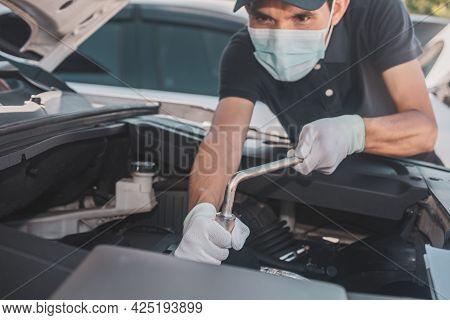 Man Wear Facemask Work Service Car Repair And Maintenance, Repairman Hands Repairing A Car Engine Au