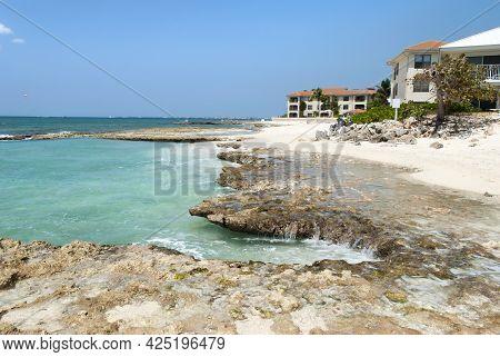 The Rocky And Sandy Seven Mile Beach On Grand Cayman Resort Island (cayman Islands).