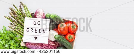 Fresh Organic Vegetables In Eco Friendly Wooden Box With Text Go Green Lightbox Flat Lay, Top View O