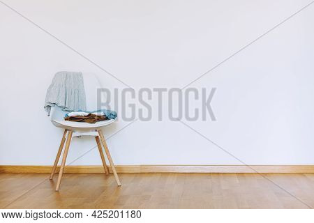 Indoors Flat Wall Mockup With Clothes On Chair In Minimalist Style. Earthy Neutrals Tones Background