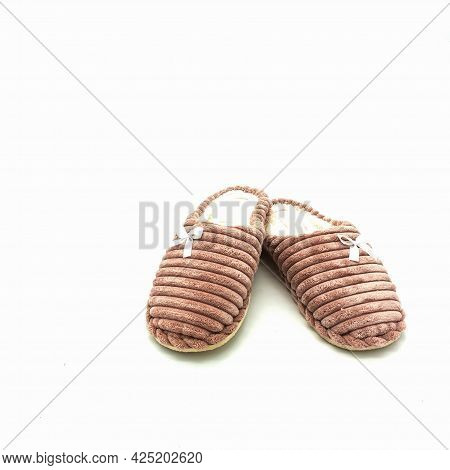 Women's Warm Home Slippers. Made Of Pink Embossed Plush, Decorated With Bows. Isolated Over White Ba
