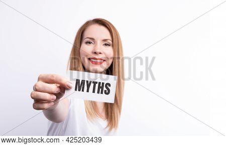 The Word Myths Young Woman Holding Blank Card Against White Background With Vignette