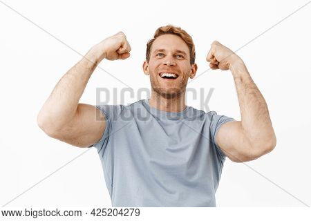Strong And Handsome Redhead Man With Perfect Body, Raising Masculine Arms Up And Celebrating, Lookin