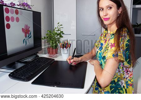 A Smiling Graphic Designer, Illustrator, Business Woman, Entrepreneur Is Working With Computer And G