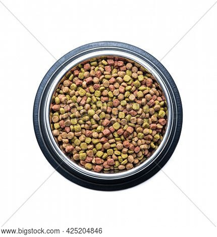 Dry kibble animal food. Dried food for cats or dogs in bowl isolated on white background.