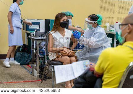 Chiang Mai, Thailand - 28 June 2021 - A Thai Woman Get Her Covid-19 Vaccine In Chiang Mai, Thailand