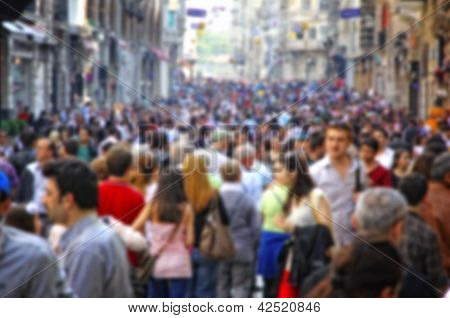 Blurred Crowd Of Unrecognizable People At The Street