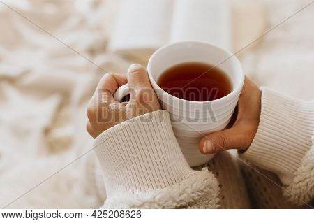 Young Woman Holding Cup Tea While Enjoying Winter Holidays. High Quality Beautiful Photo Concept