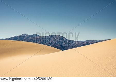 Mountains Rise From The Untouched Panamint Dunes In Death Valley National Park