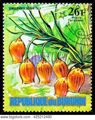 Burundi - Circa 1973: A Postage Stamp From Burundi Showing Garden Flowers Sandersonia Aurantiaca