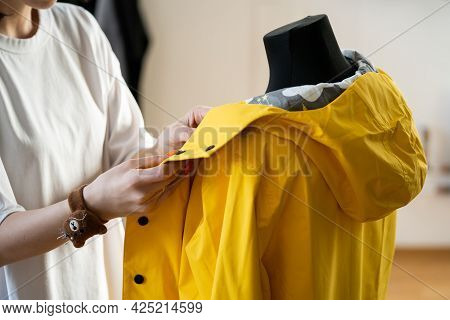 Sewer Work With Mannequin Make Adjustments To Trendy Cloak Or Raincoat On Dummy. Female Tailor In Ta