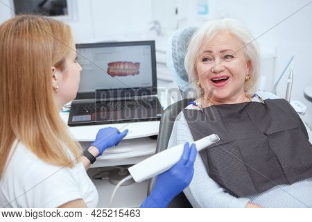 Senior Female Patient Having Dental Scanning By Her Dentist At The Clinic