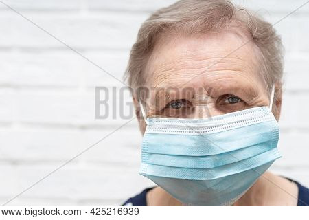 Senior Woman Wearing Face Mask During Corona Virus And Flu Outbreak. Disease And Illness Protection.