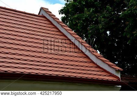 View Of The Roof Made Of Red Brick Burnt Tiles Of The Beaver Type Used In Central Europe On All Hist