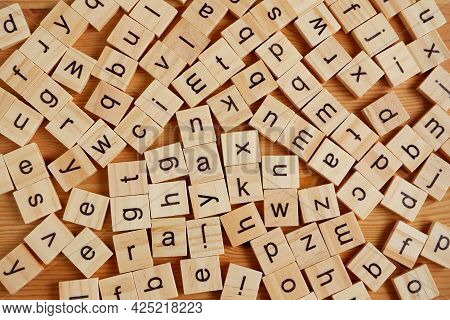Top View Of Many English Wooden Letters Scattered. Learning English Concept