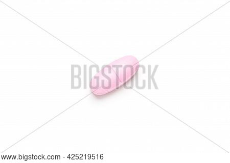 One Single Pink Pill On White Background, Multivitamin Tablet Or Dietary Supplement Close-up