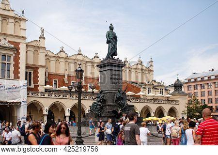Krakow, Poland - July 21, 2019: Krakow City, Old Town Square, Tourists Walking On Market Near Monume