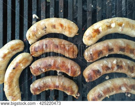 Grilled Sausages Roasting On Bbq Grill Outdoor. Grilled Food Fried In Charcoal Grills. Tasty Delicio