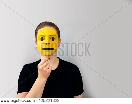 Teenage Girl Portrait, Face Painted Yellow As Emoticon, Black Mouth Meaning Lack Of Emotions On Stic
