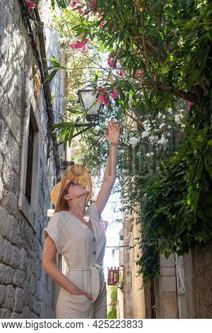 Beautiful Blonde Young Female Traveler Wearing Straw Sun Hat Sightseeing And Enjoying Summer Vacatio