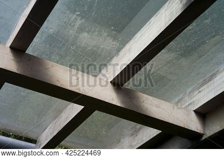 Transparent Ceiling Of Veranda With Timber Beams Needs To Be Washed