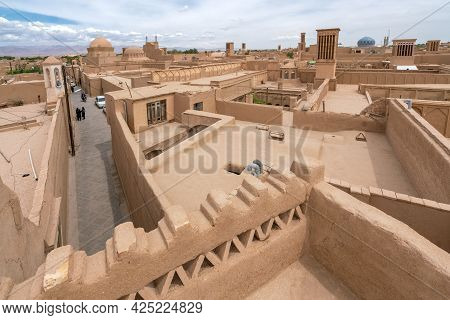 Yazd, Iran - 14.04.2019: View Of The Rooftops Of The Historical Part Of The City With Clay Buildings