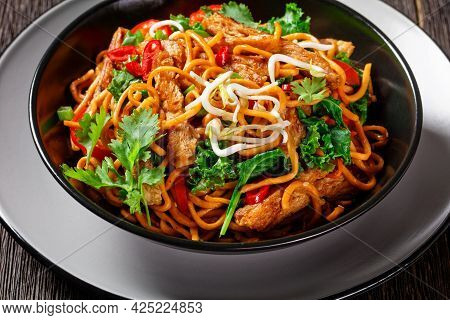 Grilled Soy Meat Strips With Spicy Egg Noodle,  Bean, Sprouts, Kale, Cilantro And Chili In A Bowl On