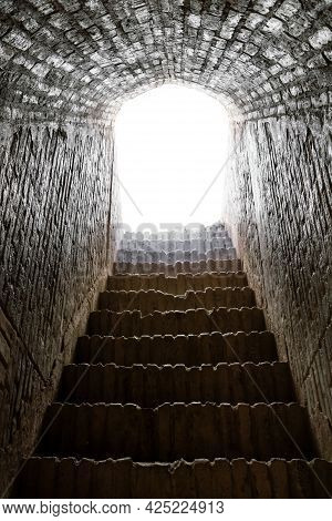 Abstract Concept For Dying Or Life After Death. Stone Stairway Leading To The Bright Light