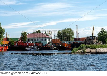 A Fleet Of Tugs Moored At The Port In The City Of Kaliningrad.