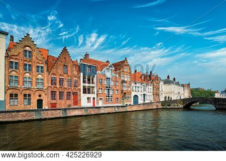Bruges typical Belgian cityscape Europe tourism concept - canal and old Flemish houses and bridge. Brugge, Belgium