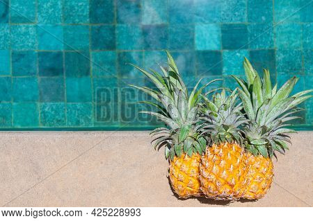 Three Juicy Pineapples By The Water. Flatlay By The Pool.