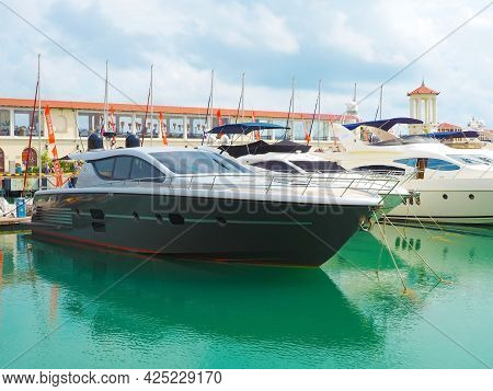 Russia, Sochi 06.06.2021. Private Yachts Are Moored In A Row At The Sochi Sea Terminal Against The B